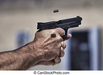 Handgun being shot