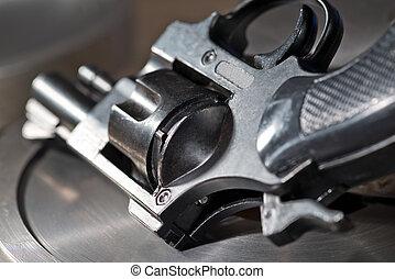 handgun - detail of a revolver on the metal desk