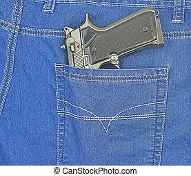 handgun in blue jeans pocket