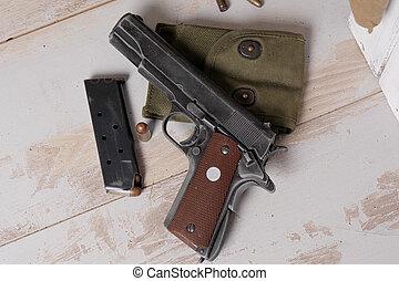 handgun M1911 government with cartridges - a handgun M1911...
