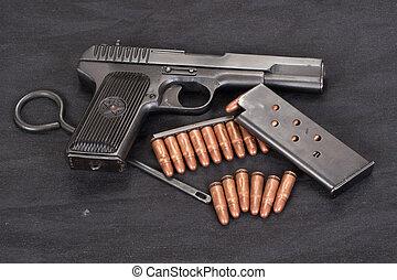 handgun on black background