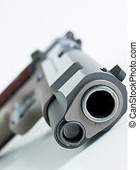 Handgun - Colt 1911 Commander is a single-action,...