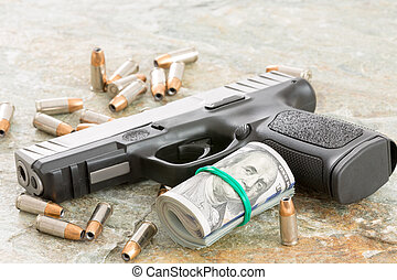 Handgun with money and scattered bullets