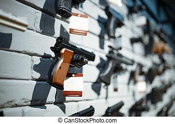 Handguns on showcase in gun shop closeup, nobody. Euqipment ...