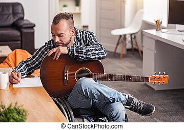 handicapé, concentré, songwriting, engagé, homme