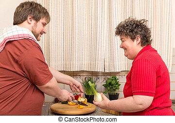 handicapé, femme, jeune homme, cuisine