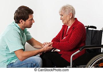 handicapé, jeune, aider, dame, infirmière