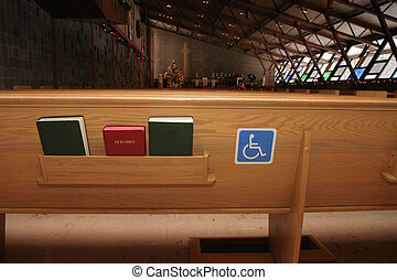 A handicapped access sign on a chruch pew.