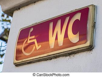 Handicap restroom illuminated sign