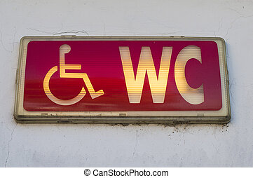 Handicap restroom illuminated sign