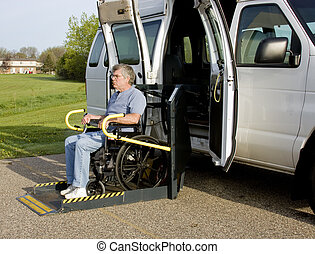 handicap wheelchair lift - handicap van with a man in a...