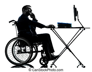 handicapped business man working in wheelchair silhouette in whe