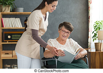 Handicapped lady relaxing with book