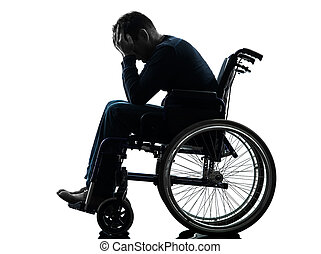 handicapped man head in hands in wheelchair silhouette - one...