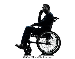 handicapped man on the telephone in wheelchair silhouette