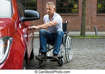 Handicapped Man Opening Door Of A Car