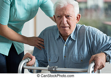 Handicapped man using walker