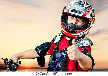Handicapped quad bike rider doing thumbs up.