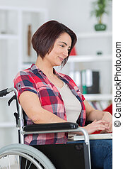 handicapped senior woman using laptop computer at home