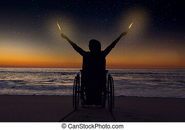 Handicapped woman holding fire sparklers