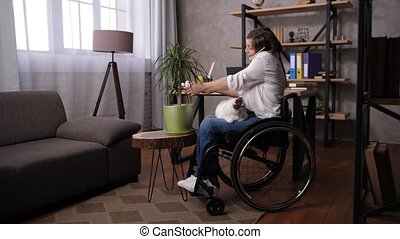 Handicapped woman in wheelchair working from home