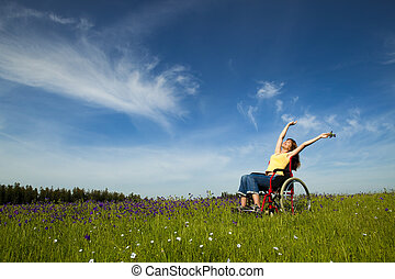 Handicapped woman on wheelchair - Happy handicapped woman on...
