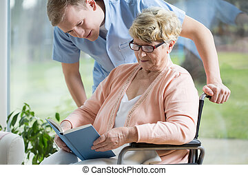Handicapped woman reading book