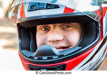 Handicapped young man wearing helmet.