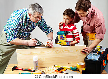 Handicraft - A grandfather and a father teaching a boy to ...