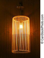 Handicraft electric lamp on wall