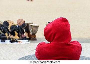 Handicraft seller on the beach, Nazare (Portugal)