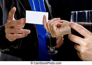 Handing a Businesscard at a Bar - businessman handing over...