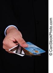 Handing Credit Cards - A businessman handing credit cards.