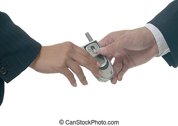 handing over a cell phone - close up of hands passing over a...