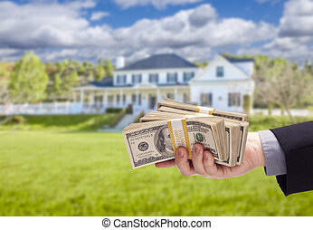 Handing Over Cash For House in Front of Home