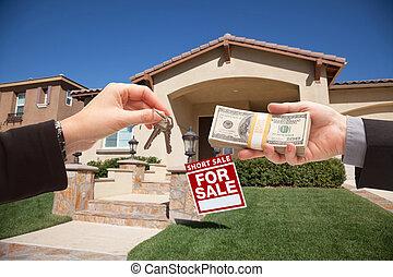 Handing Over Cash For House Keys and Short Sale Sign -...