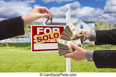 Handing Over Cash for Keys in Front of House, Sign - Man...