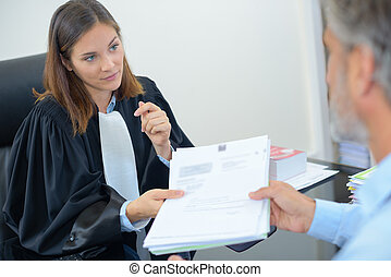 handing over notes to judge