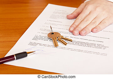 Handing over of keys after contract signing of house sale.