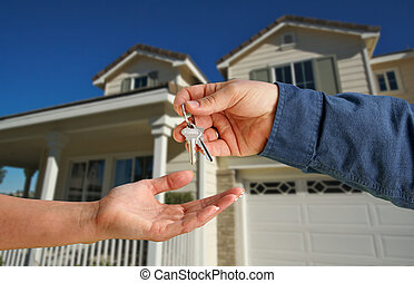 Handing Over the House Keys in Front of New Home - Handing...