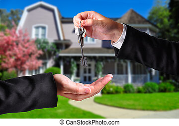 Handing over the keys - A hand giving a key to another hand...
