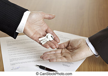 Handing over the keys after contract signing - closeup of...