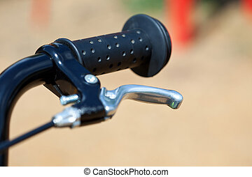 handle of a bike with the brake lever - handle of a baby...