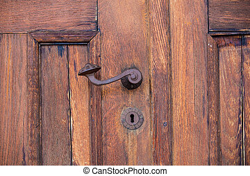 handle on the old wooden door in a castle