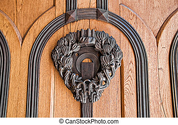 Handle on wooden door.