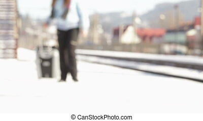 Through railway passes Girl with suitcase