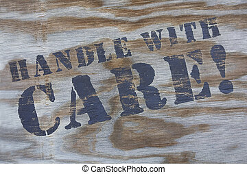 Handle With Care - Close-up of handle with care sign on...
