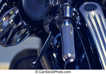 handlebar motorcycle in dark background, soft focus and blur