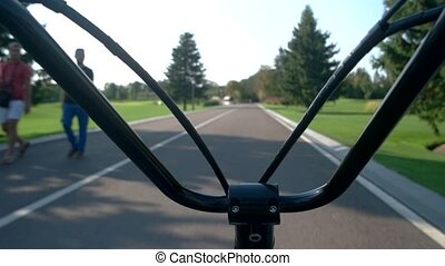 Handlebars and road background.