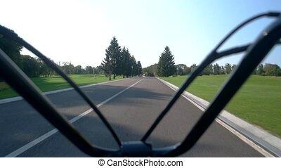 Handlebars on road background. Natural landscape and sky....